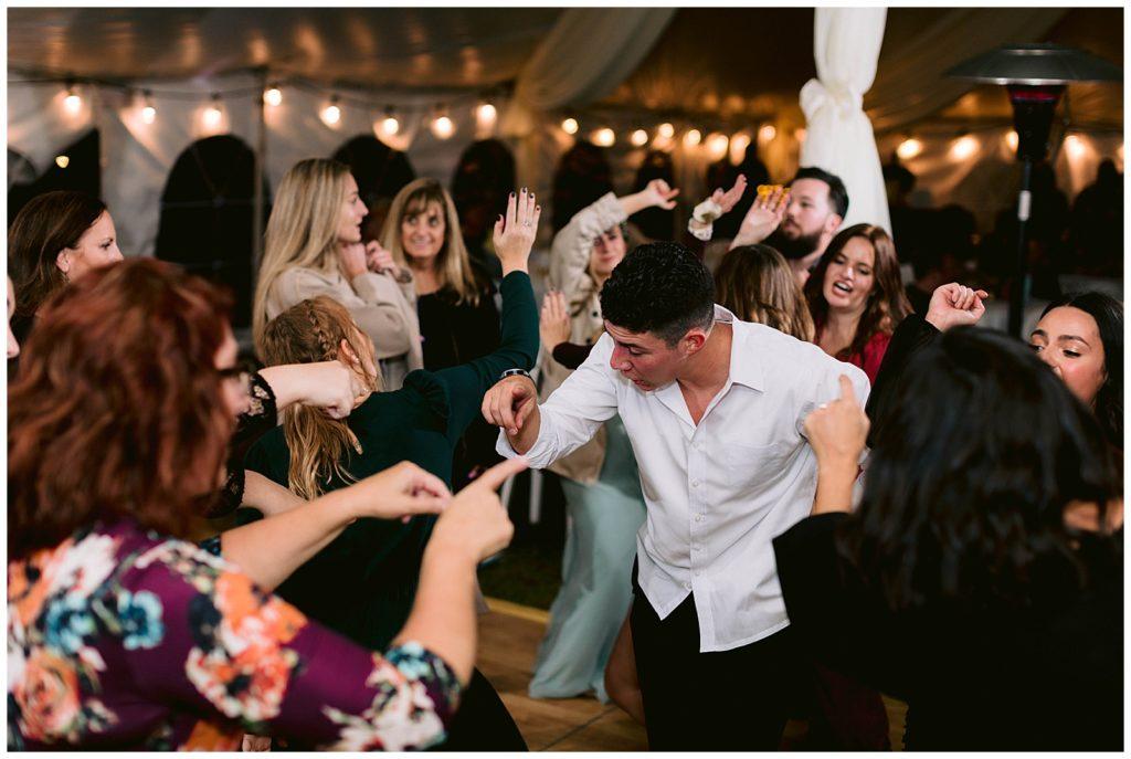 detroit michigan wedding photographer oakland county mi fun dance floor photography party reception in detroit under white tent